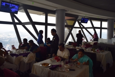 My parents enjoying the buffet at revolving restaurant @ 282m
