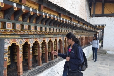 Prayer wheels outside the temple