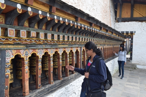 Prayer wheels outside the temple
